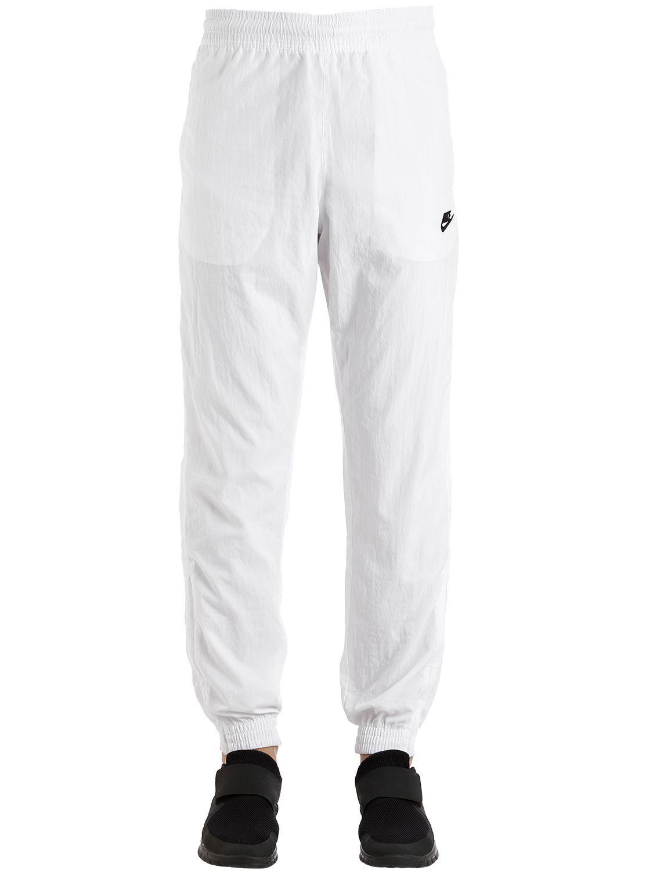4187bcc4707798 NIKE VAPORWAVE SWOOSH WOVEN TRACK PANTS.  nike  cloth