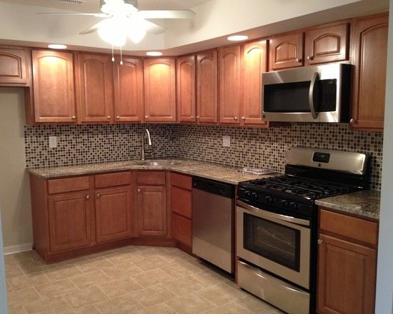Traditional Kitchen With Brown Wood Kitchen Cabinets Also Black