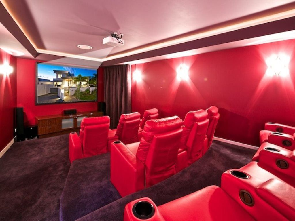 extra large media room with 3-tiered levels, sensational red