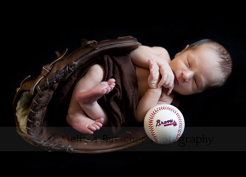 would be really cute if baby was wearing that crocheted baseball hat pattern I have