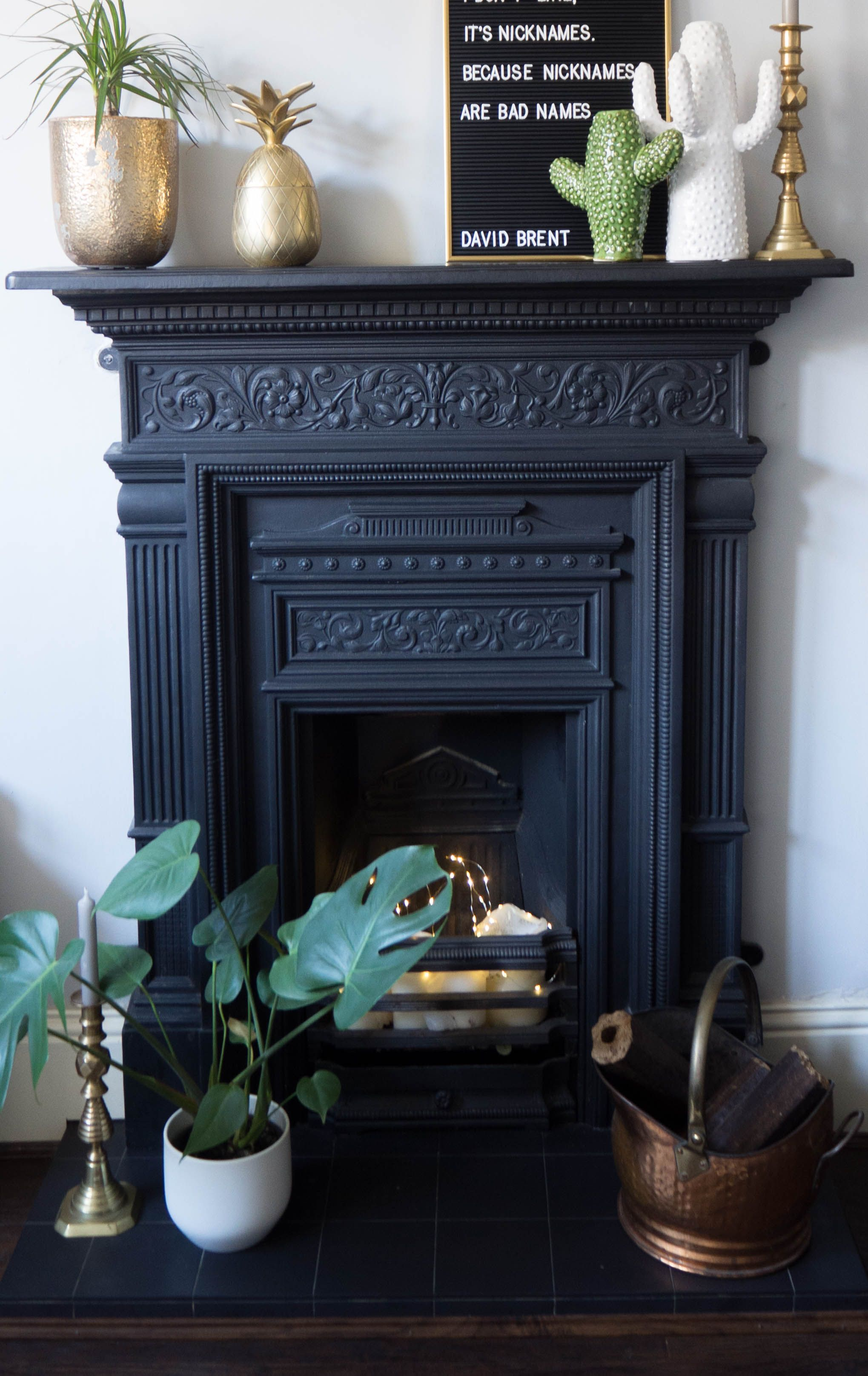 My Cast Iron Fireplace Surround With Ceramic Cactus Vases Br Pinele And A Letter Board