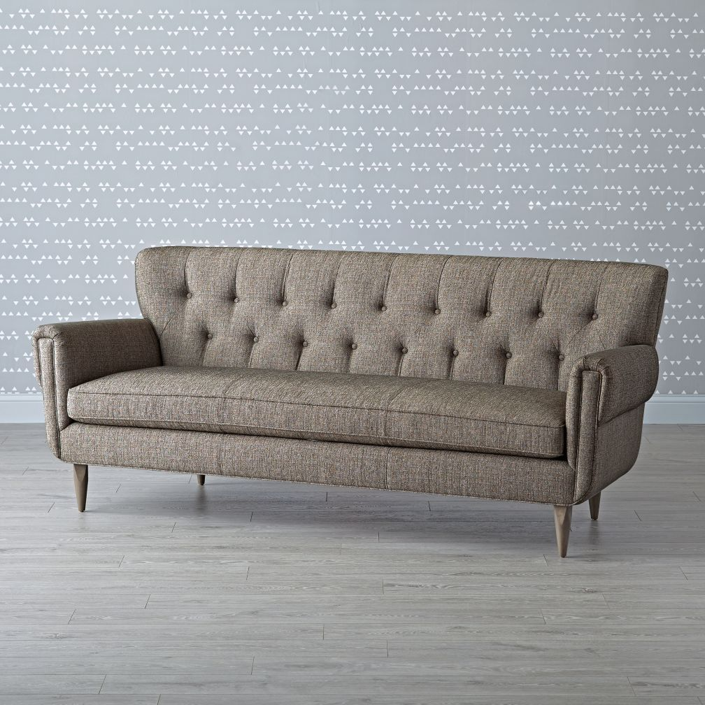 Shop kid friendly neutral sofa our mid century chesterfield sofa is designed to accommodate every member of your family the classic wingback design gives