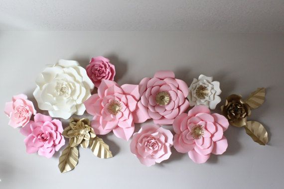 Please note: Production is currently 6-8 weeks. As Seen on: Brooke & Jane http://lifeofbrookeandjane.blogspot.com/  Handmade paper flowers. Can be used as a backdrop for any type of event or as a statement piece in the home or retail boutique. This listing is for a set of 12 mixed sizes giant paper flowers with 2 GOLD FLOWERS & 4 GOLD leaves as shown.  The flowers come fully assembled and unattached to one another. Please note: rose type flowers DO NOT have gold centers. Flowers may slightly…