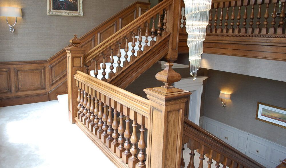 Staircase+with+panelled+newel+post+and+cut+finials+