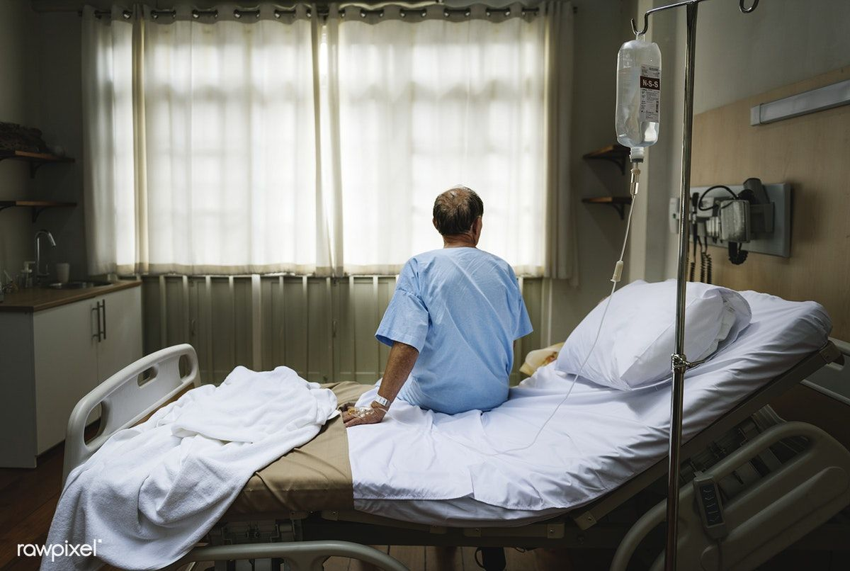 Download premium photo of A sick elderly staying at a