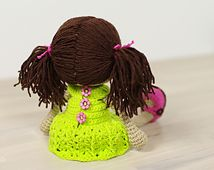 This written crochet pattern includes all the instructions needed to make your own doll with cute pigtails and removable dress and shoes.