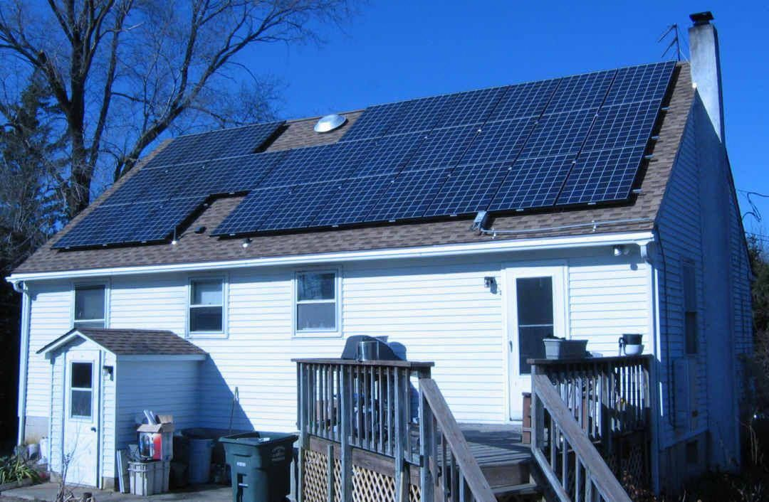 Putting new shingles and solar panels on the roof
