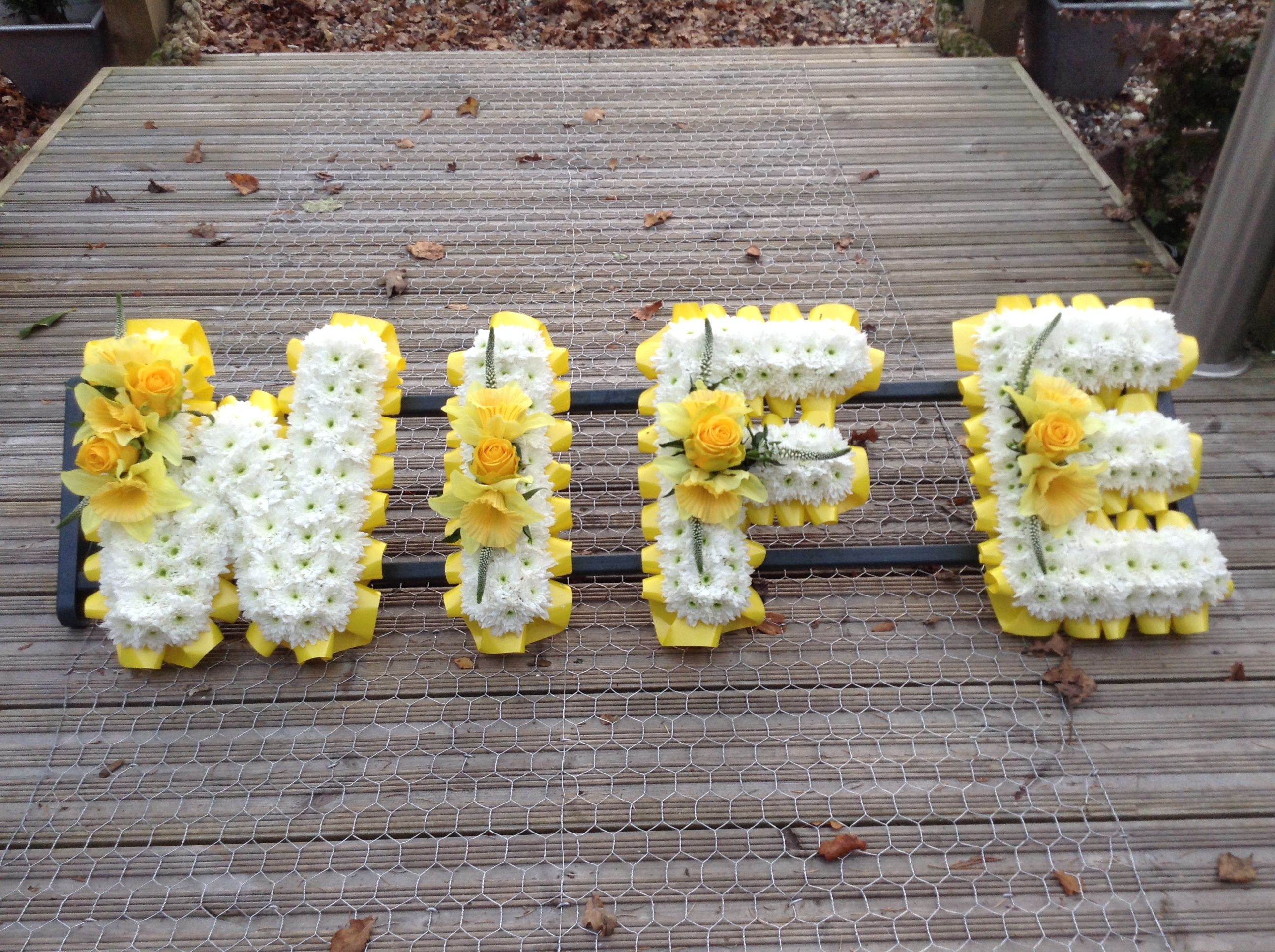 Funeral flowers wife funeral flower letter tribute beautiful funeral flowers wife funeral flower letter tribute beautiful yellow and white with stunning yellow roses dhlflorist Choice Image