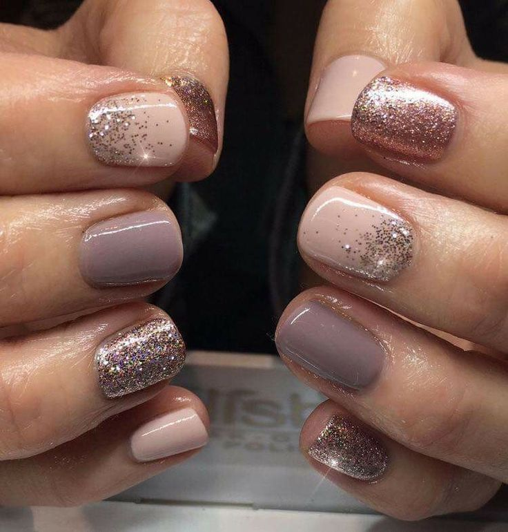 Photo of light pink and taupe nails with coppery glitter accents.