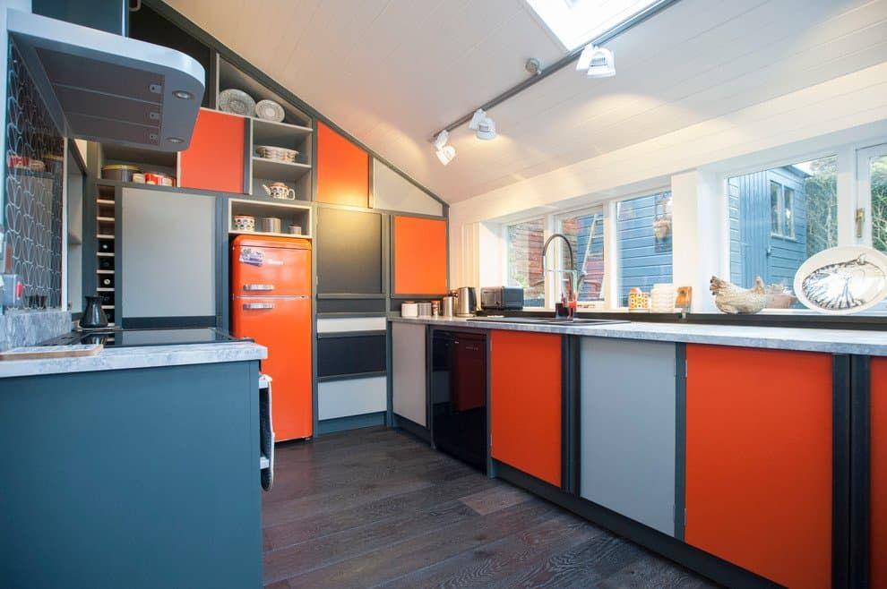 Color-block orange and blue kitchen