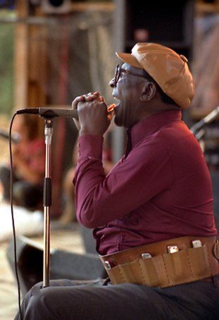1987 ♦ Sonny Terry (1911 - 1986) - blind American Piedmont blues musician. He was widely known for his energetic blues harmonica style, which frequently included vocal whoops and hollers, and imitations of trains and fox hunts.