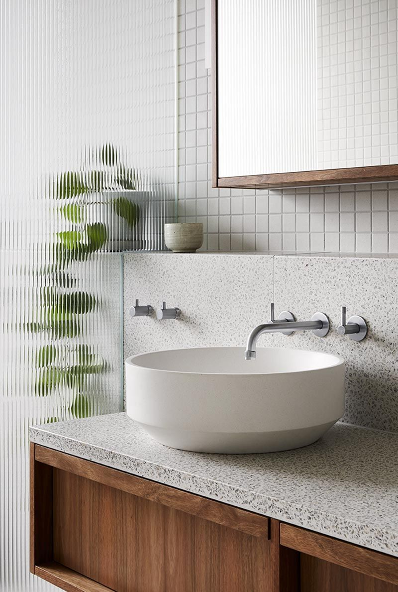 Photo of This Modern Bathroom Is Filled With Terrazzo Tiles And Countertop