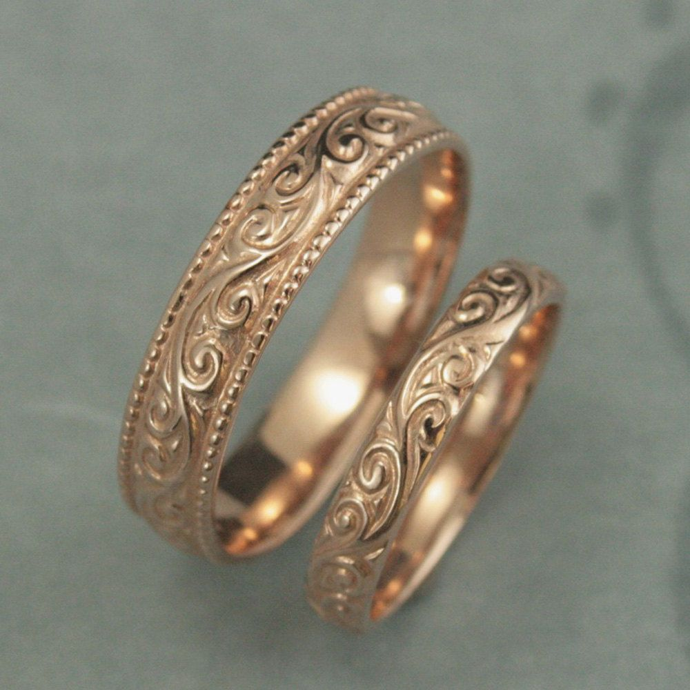 https://www.etsy.com/listing/193854689 This is a wonderfully lovely set for a wonderfully lovely couple! It features a vintage style design with a modern twist to it. Cast in solid 14K gold, it features a swirling design around the entire outer surface.The wider band measures 5.5mm wide by 1.5mm thick. It features a lovely milgrain edge.The thinner band measures 3.5mm wide by 1.5mm thick and features the matching design without the edge.These are quality solid gold rings to last you a..