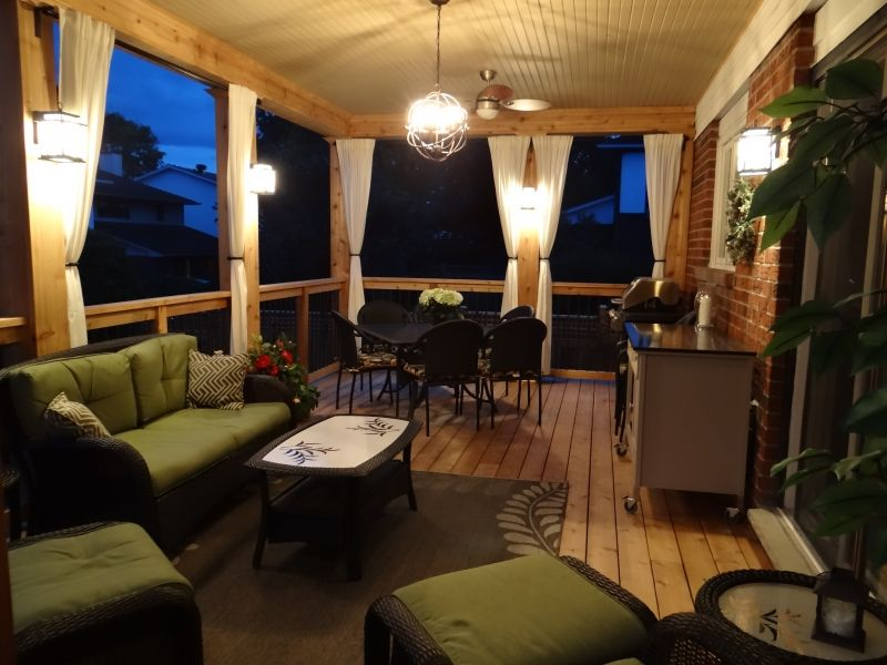 Complete outdoor living deck with finished roof and lighting ottawarenovationgroup decks