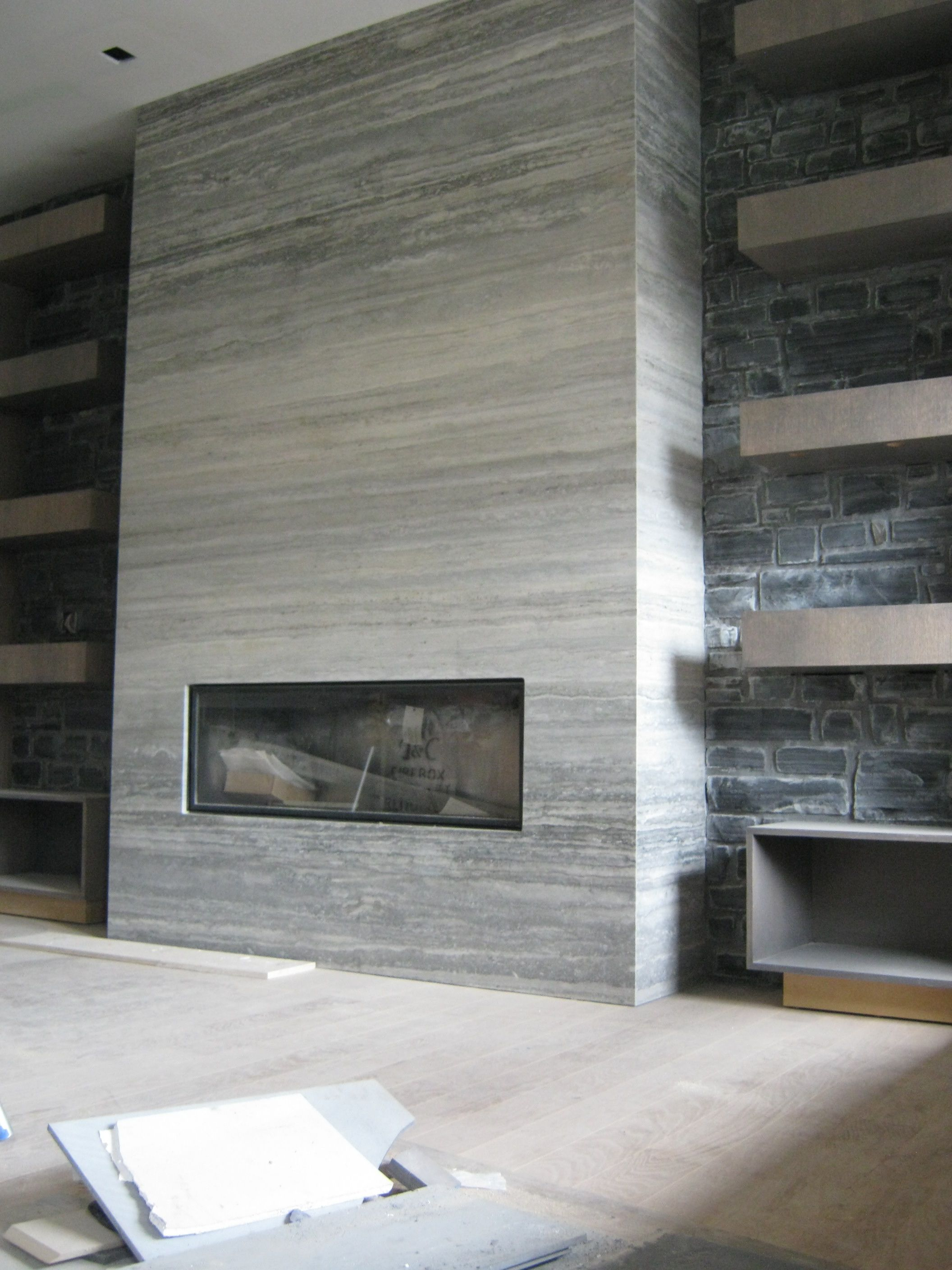 Modern Tile Fireplace With Floor To Ceiling Shelves On Both Sides