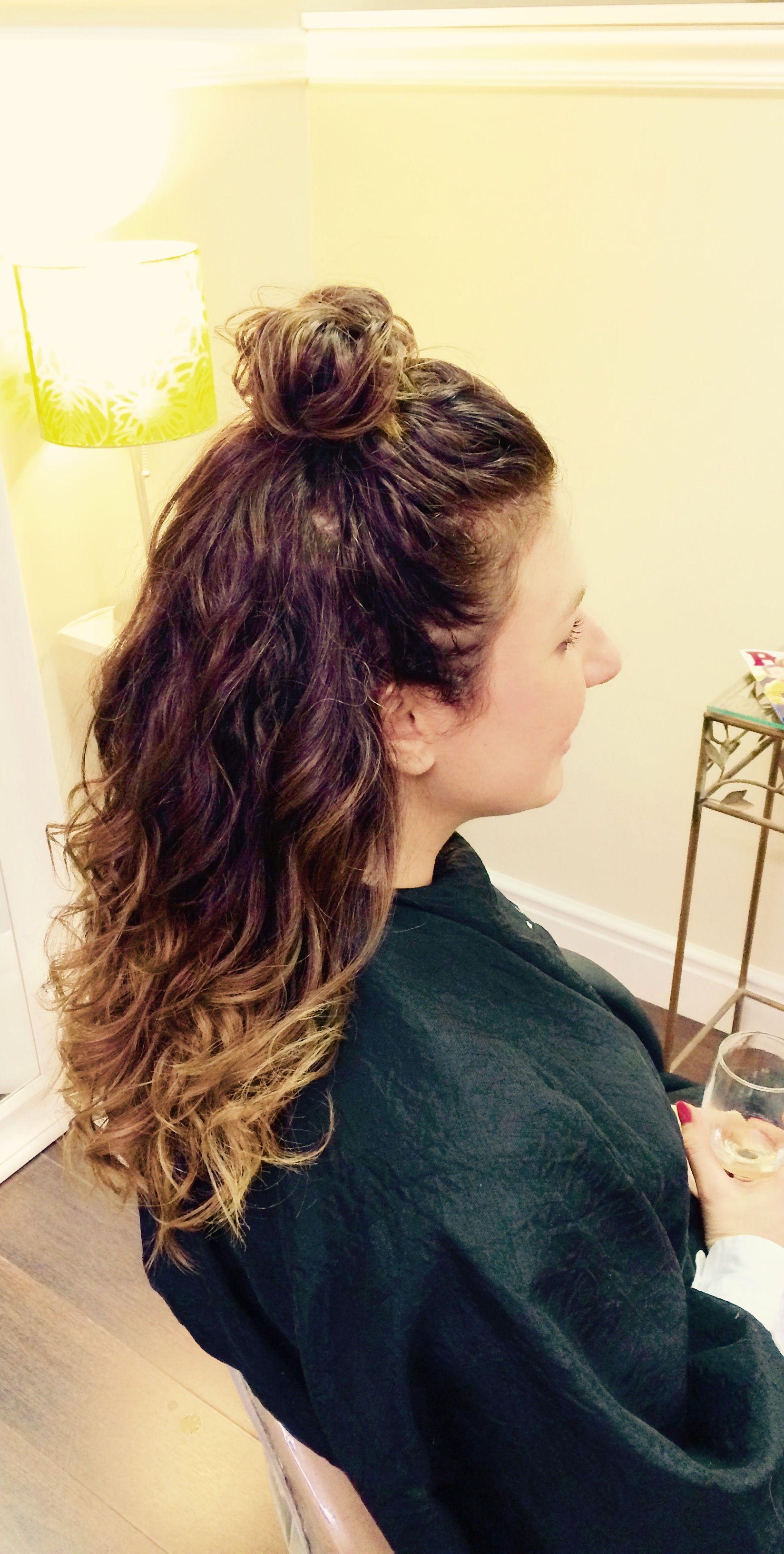 Natural curl with high bun Half up half down Loose curls