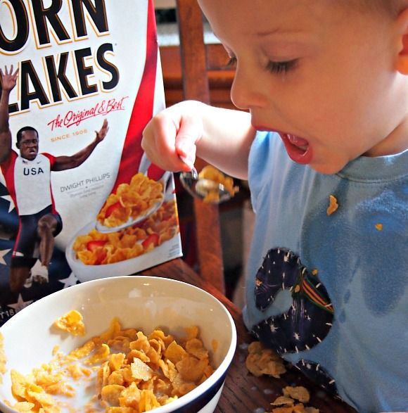A Little Boy Who Wishes To Be An Athlete Eating Corn Flakes With