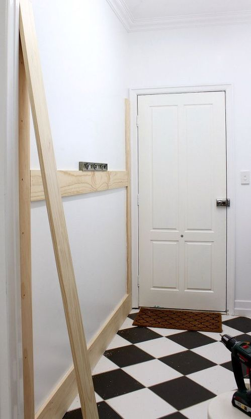 A homeowner nails boards to the wall. A few steps later? This entryway organizing idea is gorgeous: #boardandbattenwall