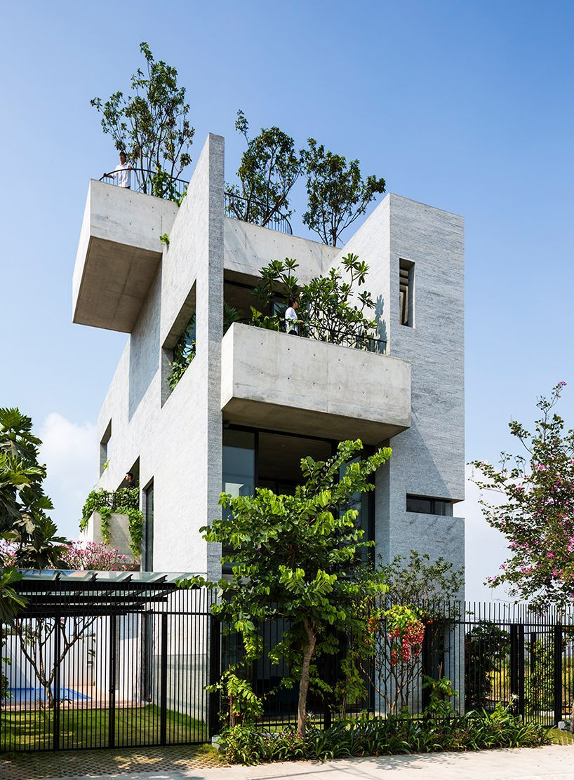 Gorgeous concrete house is stacked with courtyard gardens ...