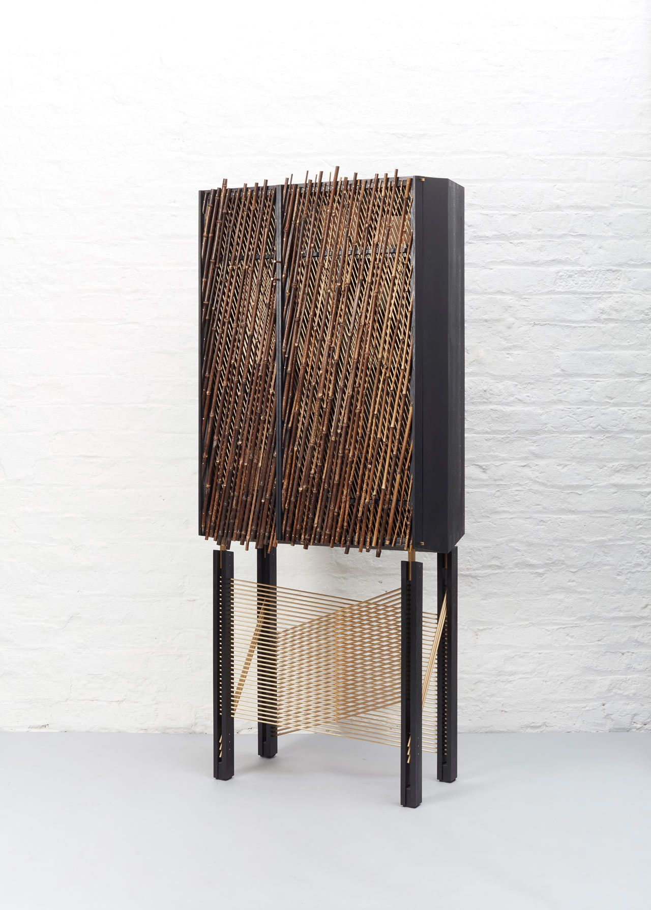 A Shadow Inspired Drinks Cabinet by Hugh Miller