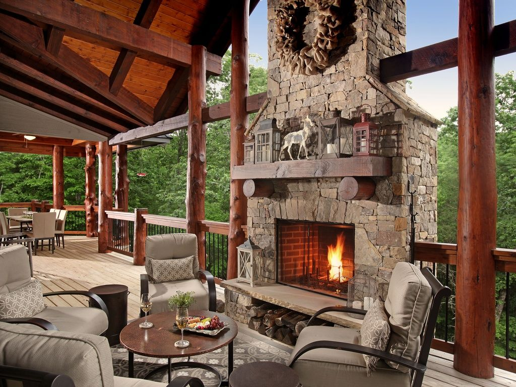 Rustic deck with outdoor fireplace wrap around porch Modern rustic farmhouse plans