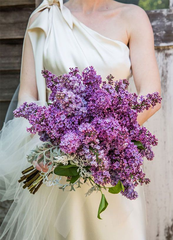 10 Spring Wedding Trends For The Floral Lover: An oversized bouquet of lilacs is accented by a few leaves of dusty miller.
