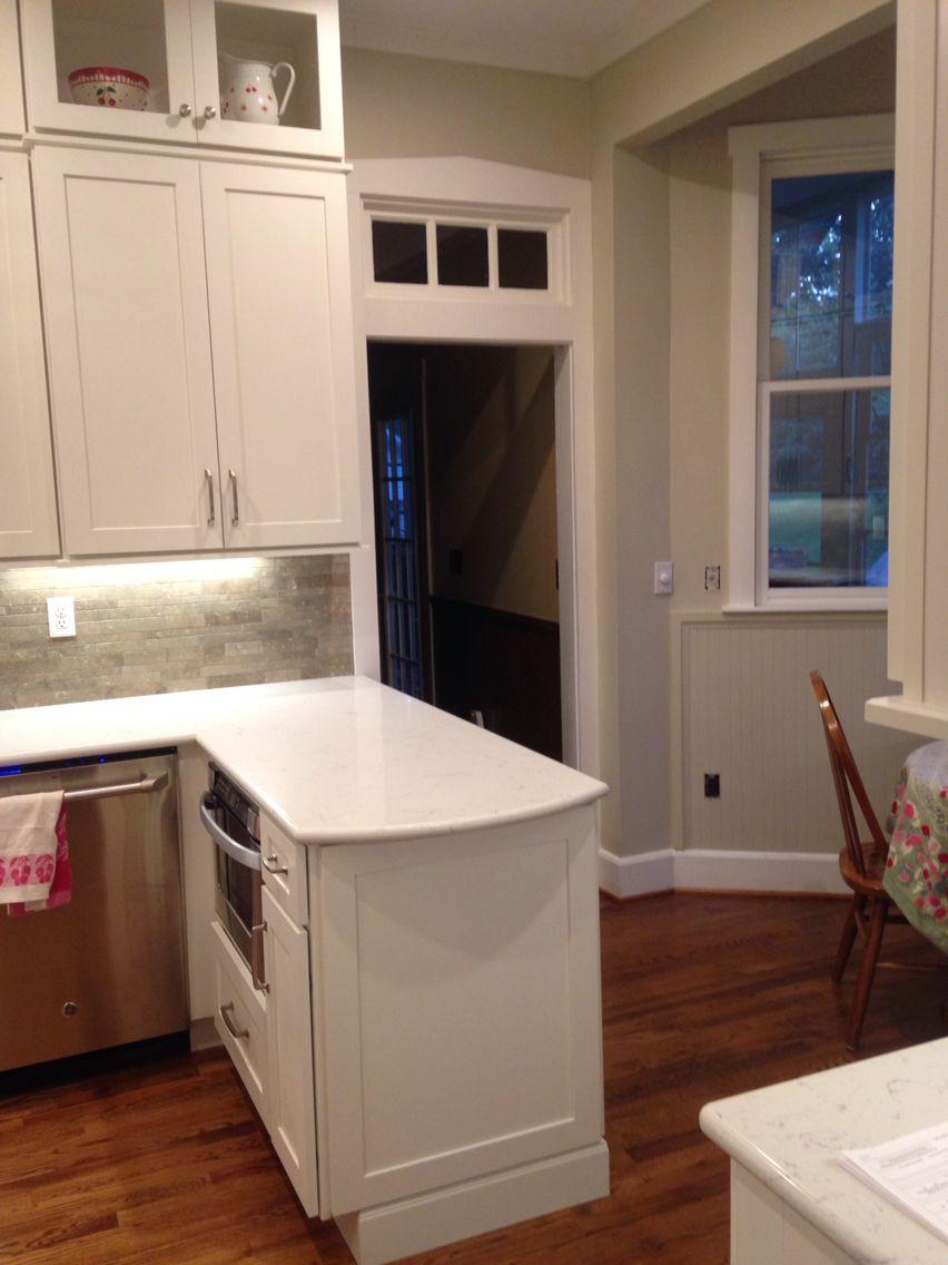 cliqstudios dayton cabinets ge cafe appliances seagrass limestone random brick backsplash carrera quartz