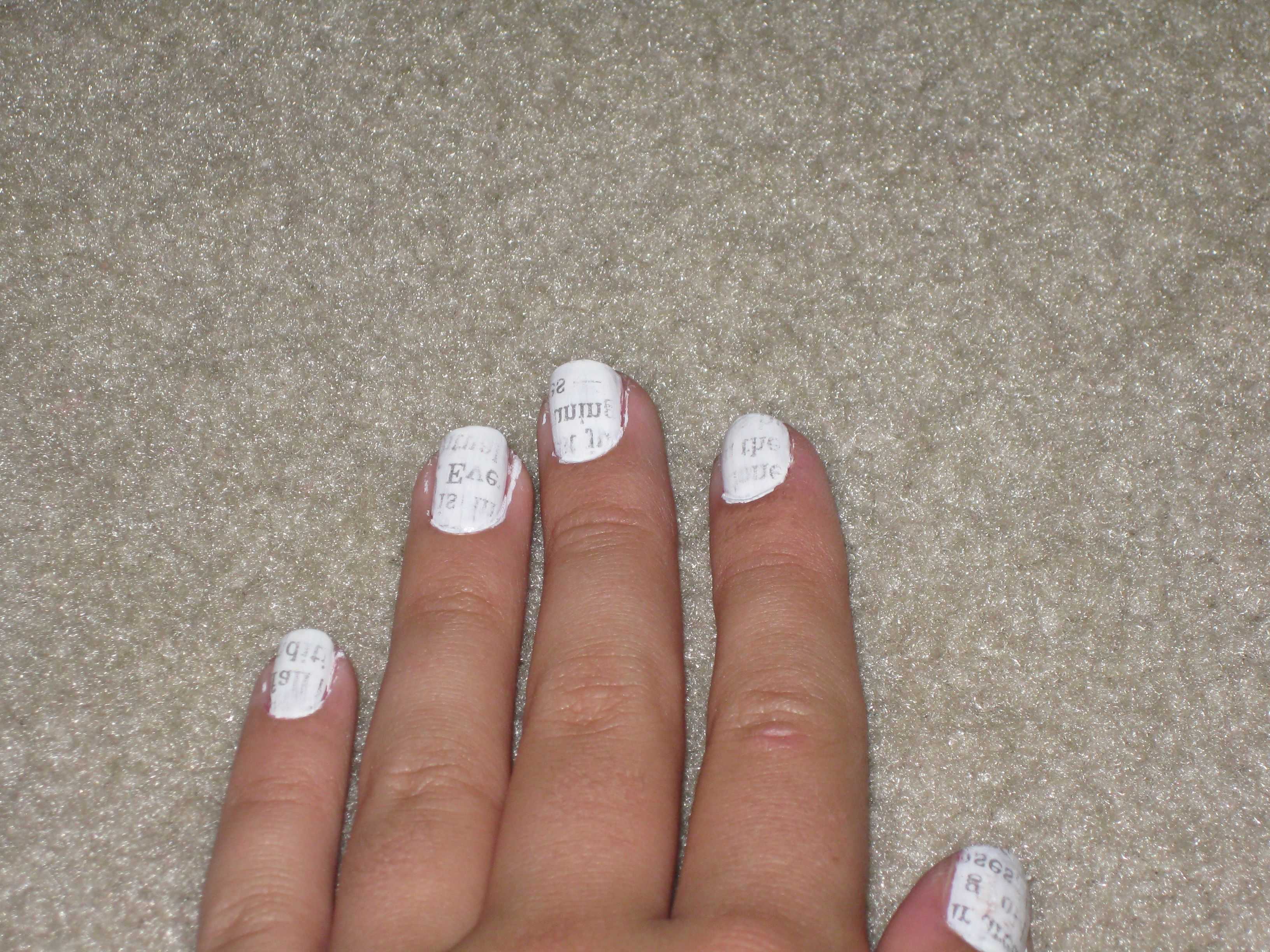 Newspaper nail design. Very Easy!  Paint nails white  Dip nail in rubbing alcohol for 5 to 10 seconds  Press newspaper print down firmly  Release paper.   Put a top coat!