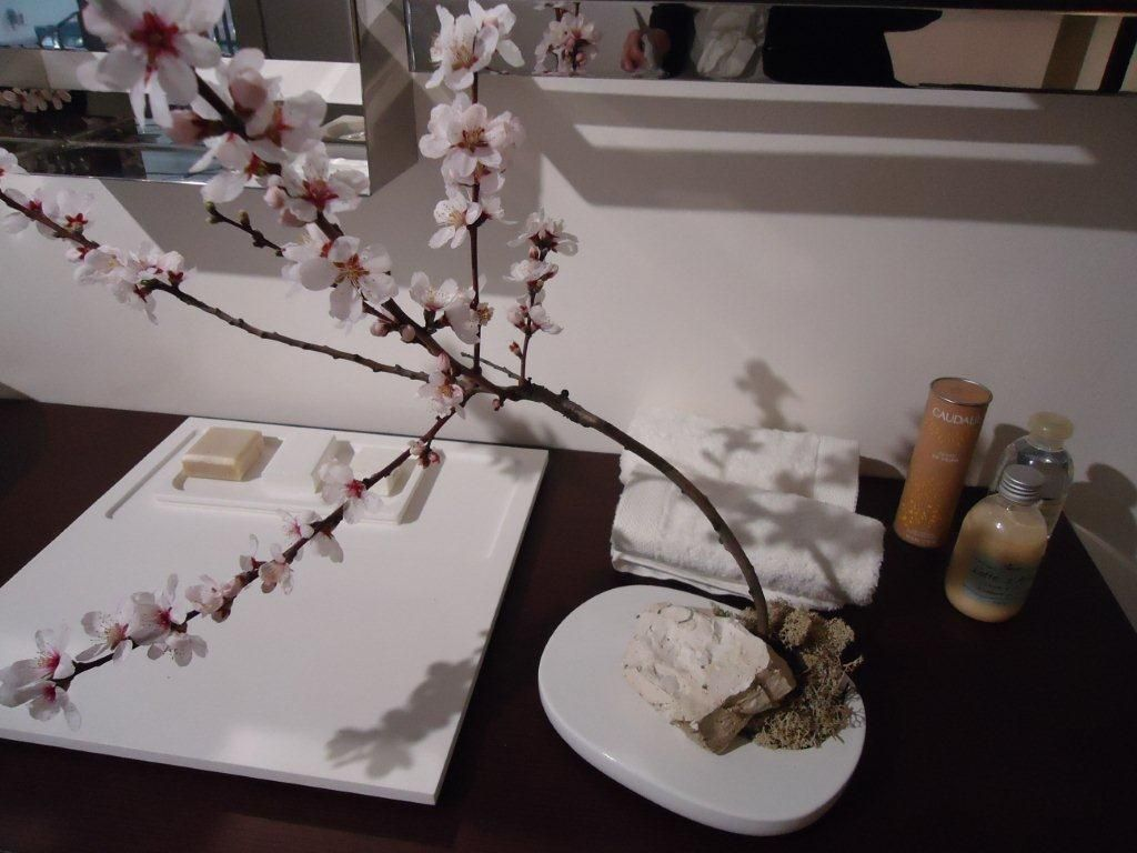Even the bathroom can be decorated with fresh flowers.  A branch of romantic and delicate peach flower and spring is here!