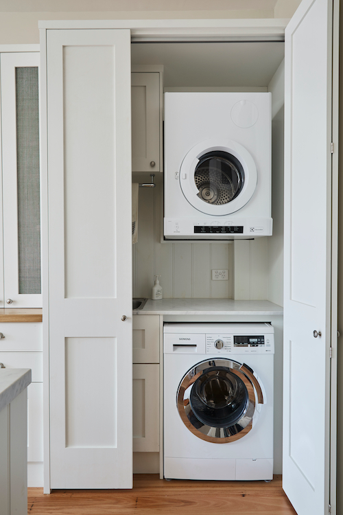 Laundry Ideas How To Hide One In The Kitchen Laundry Cupboard