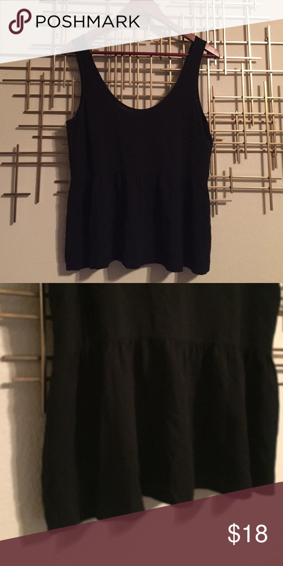 Loose Peplum Crop Top Super cute top! Great for layering or worn on its own! Worn only a few times. Scoops low in back (mid back). I'm 5 ft and the bottom of the top hits at the hips. Forever 21 Tops