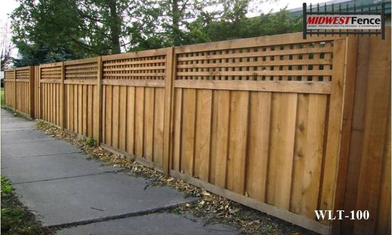 A Lattice Top Is Added To This Wood Privacy Fence That Is