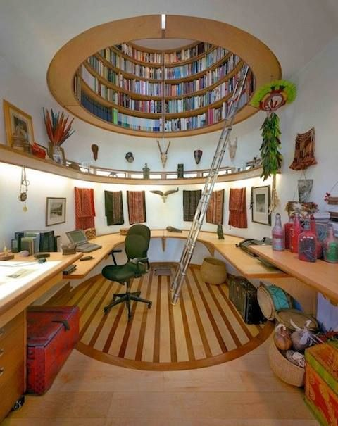 Creative working space with overhead library. Love the use of space, but would put in curved open windows.