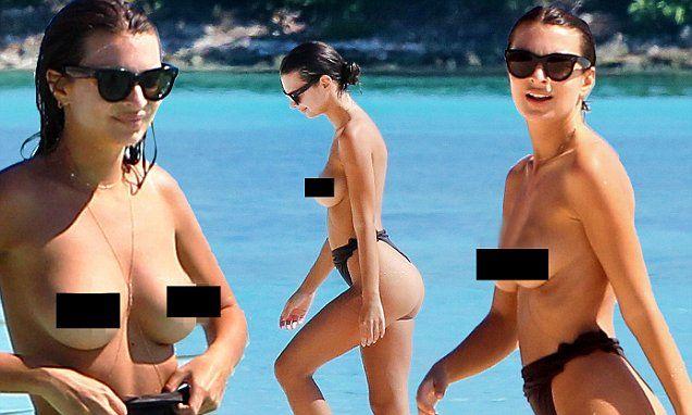 Emily Ratajkowski goes topless as she whips off swimsuit ...