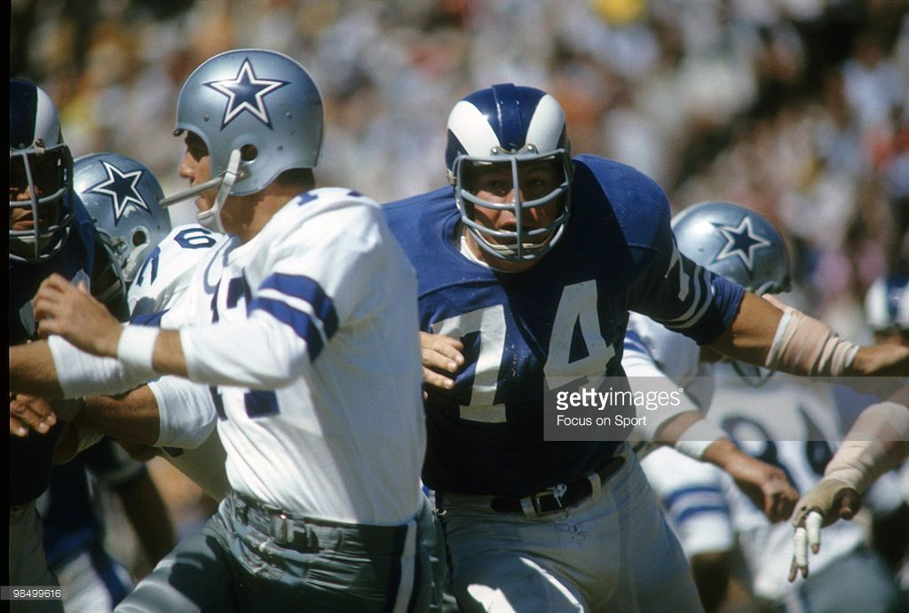 The Los Angeles Rams Merlin Olsen (74) closes in on quarterback Don Meredith in this 1967 game at the Cotton Bowl. The Rams clobbered Dallas that day, 35-13.