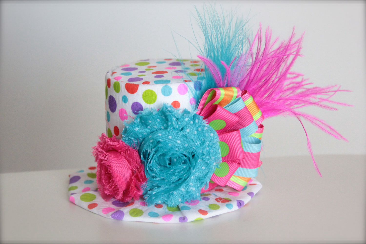 over the top circus clown inspired pink orange green and blue mini top hat headband perfect. Black Bedroom Furniture Sets. Home Design Ideas