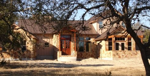Hill country homes hill country stone home with john for Texas hill country home builders