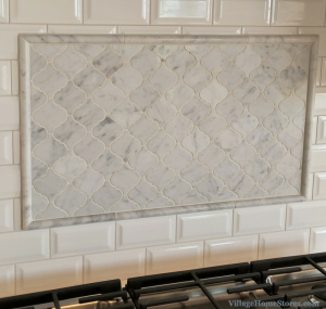 Carrara Marble Accent Area Surrounded By Beveled Subway Tile In