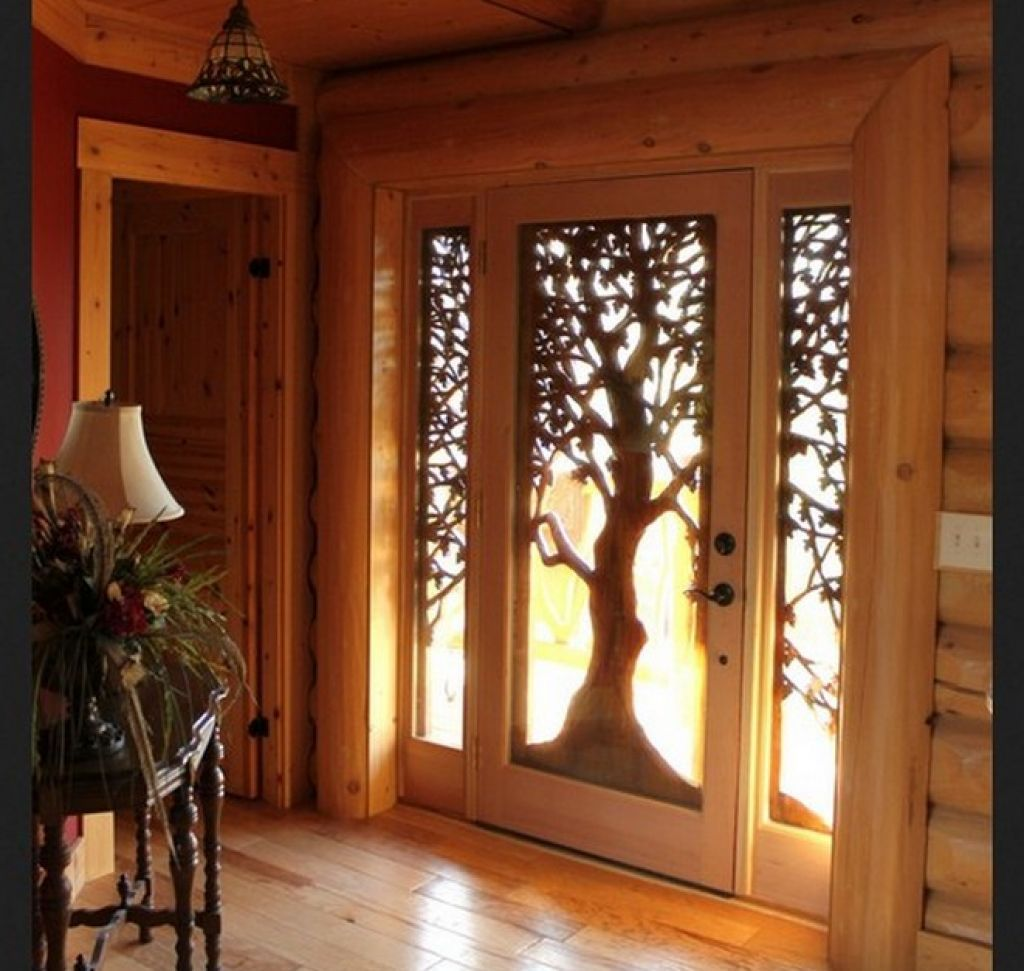 Glassed wooden front door design with tree decoration for the unique touch using shaded glass for the cover