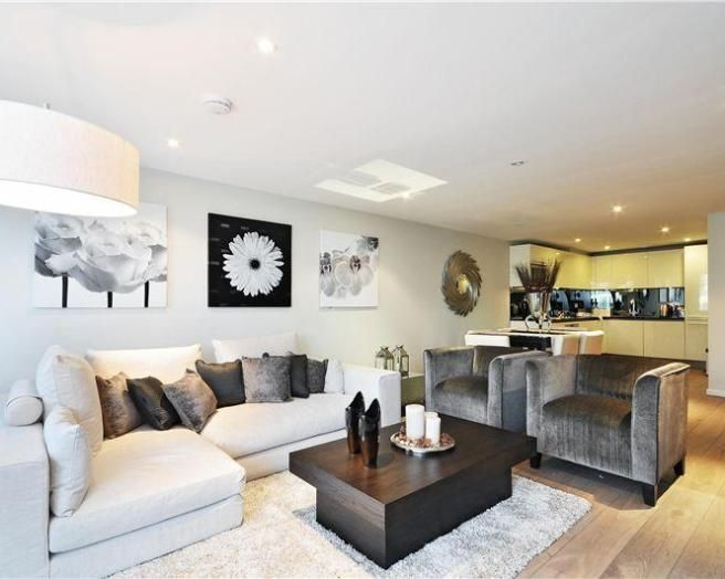 Section Off Living Space With Chairs And Sofa Facing