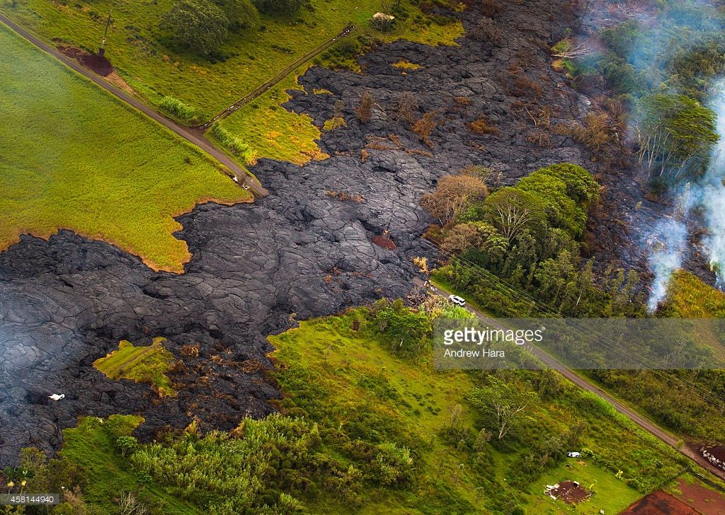 Lava From The Kilauea Volcano Flows Across The Ground On October 2014 In  Pahoa, Hawaii. Molten Rock From The Flow Is Inching Its Way Towards Homes  In The ...