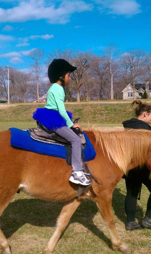 This is me riding on a horse in girl scouts.