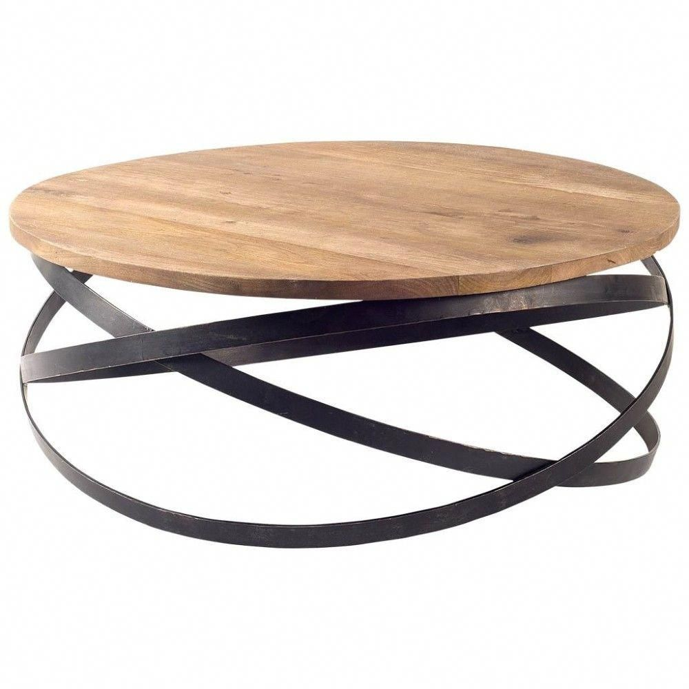 Bristol Round Industrial Coffee Table is part of Industrial Living Room Table - Add an artful touch with the Bristol Round Industrial Coffee Table  As if in perpetual motion, the iron circles that comprise its base appear different from every angle  A top in darkstained Indian mango wood provides warmth and contrast while serving as a wonderful focal point in your den or barroom  • Round coffee table • Natural mango wood top • Metal base with black finish