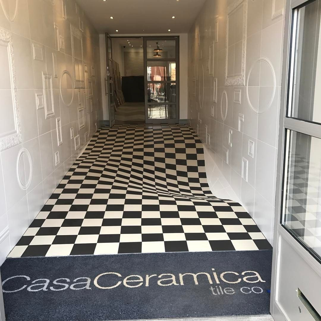 British Tile Company Creates An Amazing Curving Floor Optical Illusion For Their Showroom Entrance