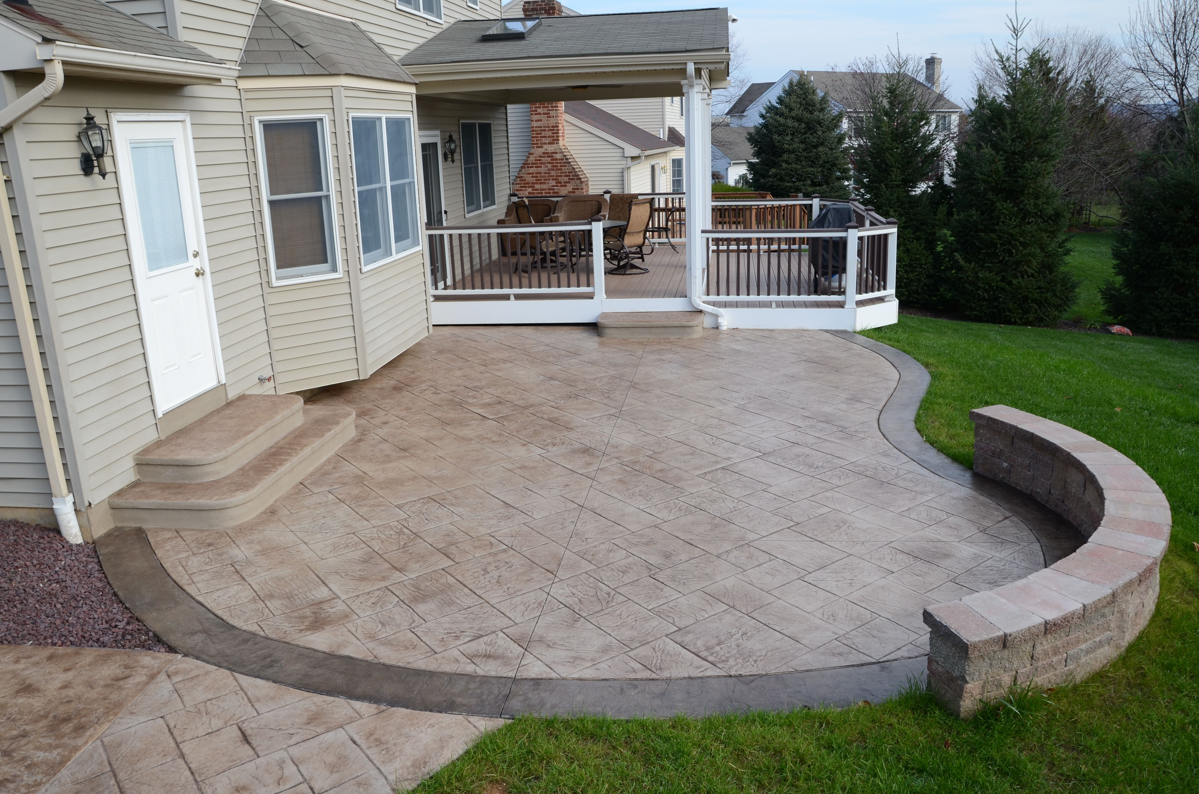 stamp concrete patios  Stamped Concrete Patio add bench around fire pit  Landscape in 2019