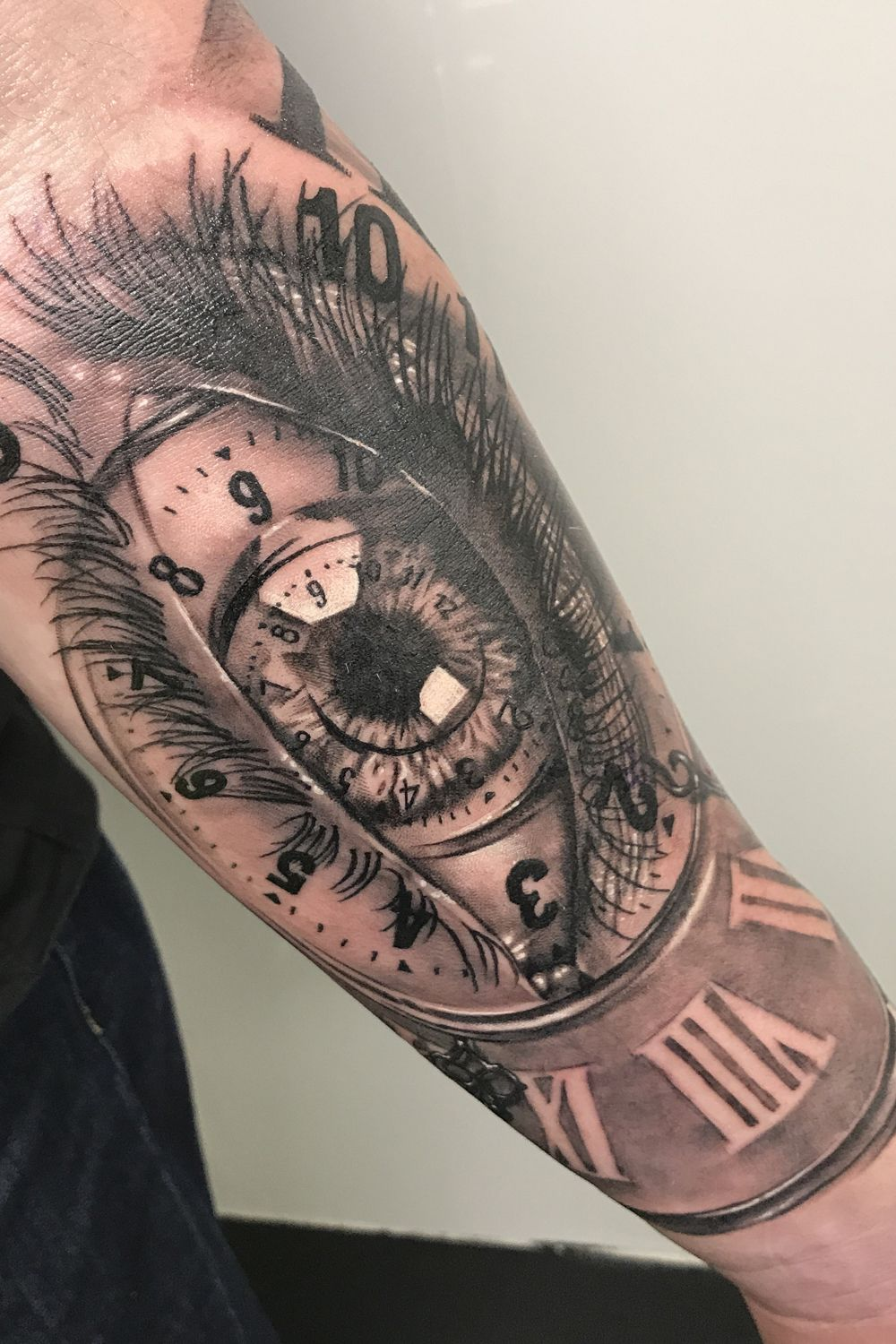 Clock and Eye black and grey realism tattoo. To see more