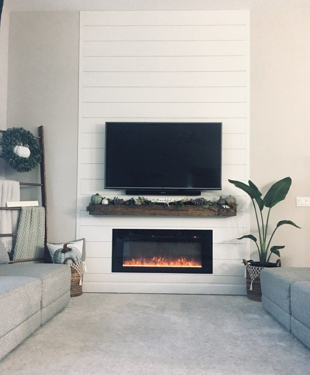 DIY Easy and affordable Farmhouse shiplap fireplace wall