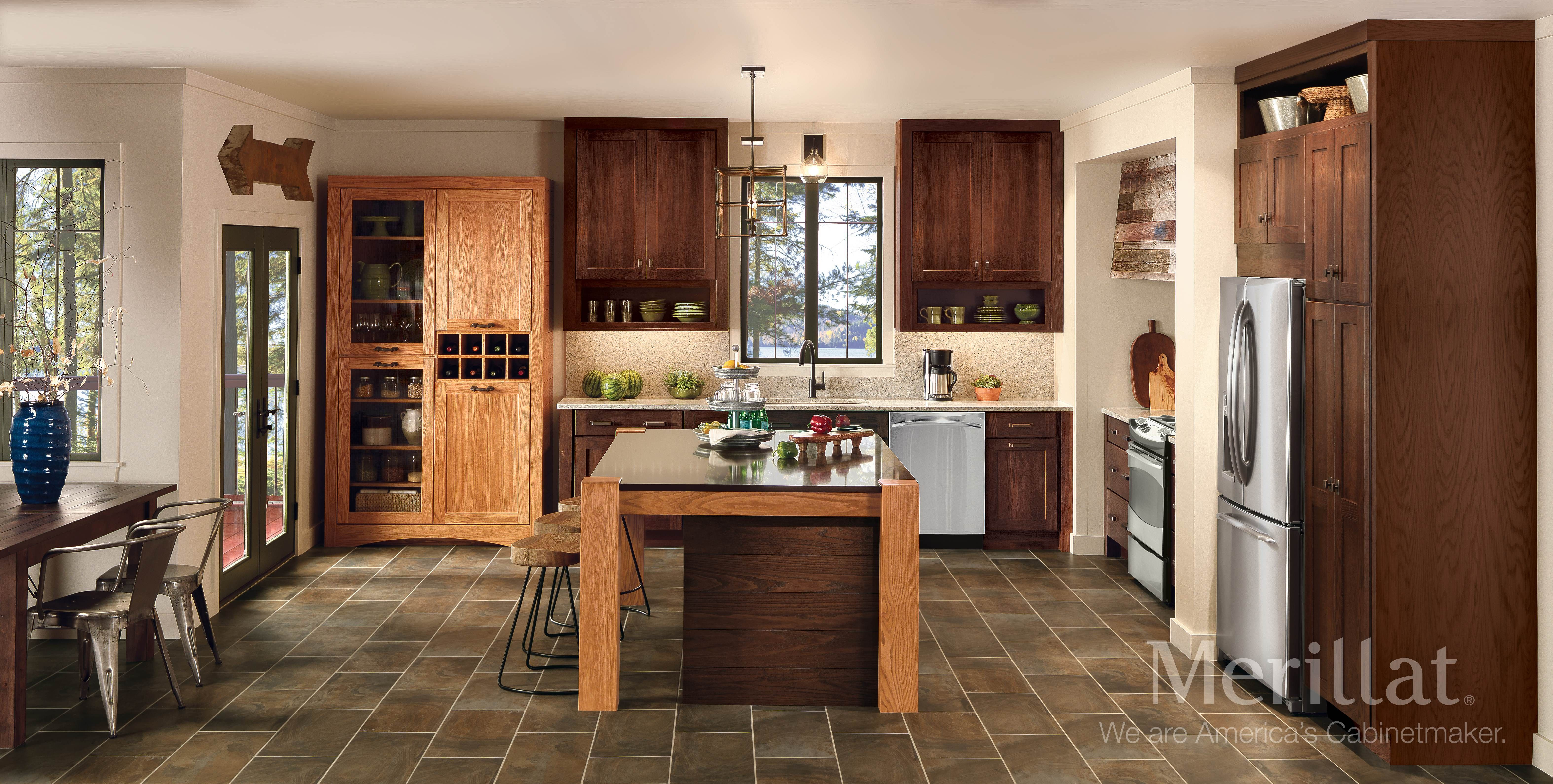Merillat Classic Tolani Oak Pecan And Hazelnut Merillat Cabinetry Contrasting Finishes Give This Kitchen Design Trends Kitchen Design Kitchen Color Trends