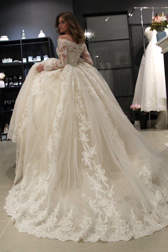 Photo of Princess royal off shoulder wedding dress Nuria by Olivia Bottega. Beading Lace wedding dress. Long sleeve wedding dress.