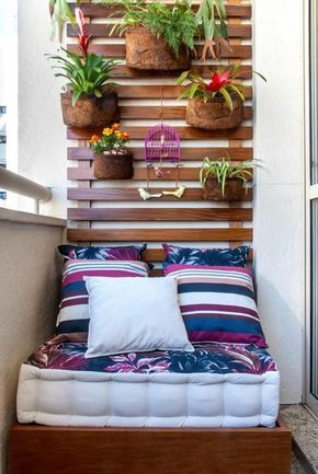 Contemporary small patio ideas with beautiful leaf pattern mattress includes cute pillows under growing garden flower attached on wooden wall decor